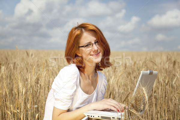Young Businesswomen in white working with notebook at wheat fiel Stock photo © Massonforstock