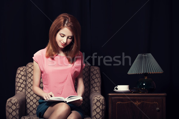 Redhead girl in armchair. 70s Stock photo © Massonforstock