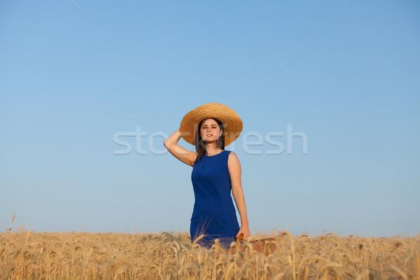 Ragazza valigia campo di grano bruna estate tempo Foto d'archivio © Massonforstock