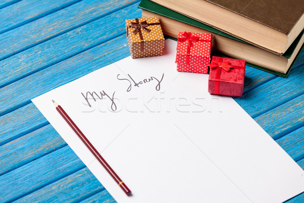 photo of paper My story, cute gifts and pile of books on the won Stock photo © Massonforstock