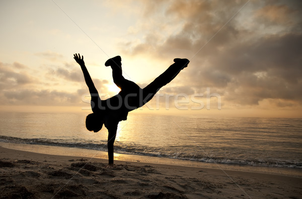 Cartwheel on the sunset  Stock photo © Massonforstock