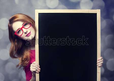 Redhead student with blackboard. Stock photo © Massonforstock