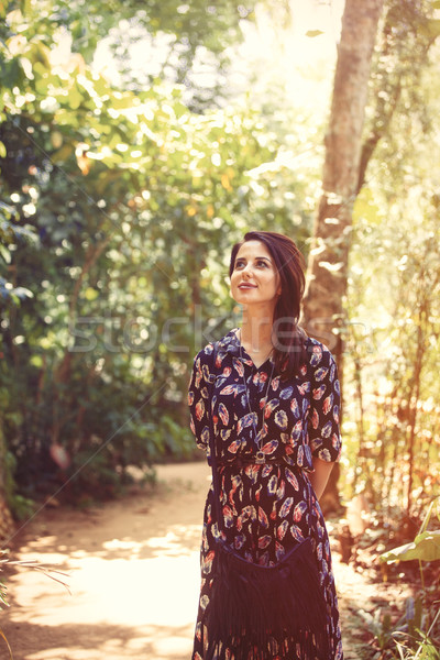 woman in a tropical park Stock photo © Massonforstock