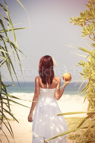 woman with coconut cocktail Stock photo © Massonforstock