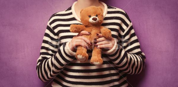 Woman holding teddy bear toy Stock photo © Massonforstock