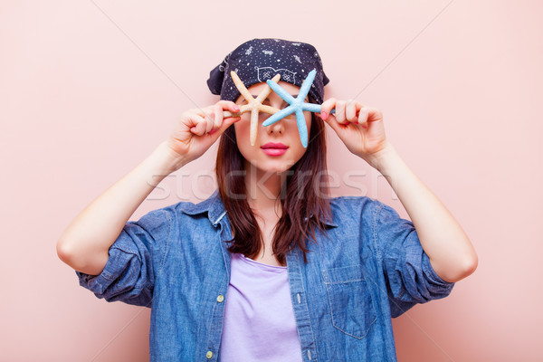 portrait of a young woman with starfishes Stock photo © Massonforstock