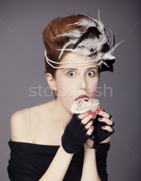 Redhead girl with Rococo hair style and cake in studio at vintag Stock photo © Massonforstock