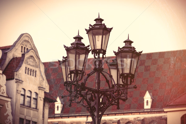 photo of beautiful lamp post and vintage old roof in Wroclaw, Po Stock photo © Massonforstock