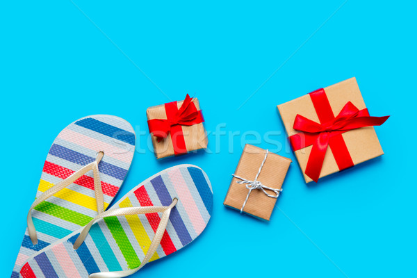 colorful sandals and beautiful gifts on the wonderful blue backg Stock photo © Massonforstock