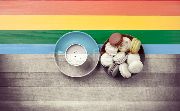 photo of cup of coffee and plate full of macaroons on the wonder Stock photo © Massonforstock