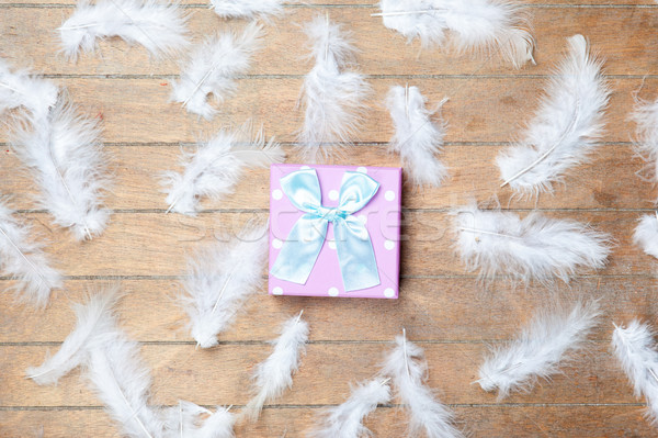 photo of cute gifts near bird feathers on the wonderful brown wo Stock photo © Massonforstock