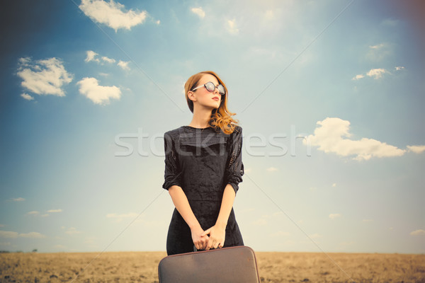 photo of beautiful young woman with suitcase on the wonderful fi Stock photo © Massonforstock