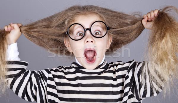 Fiatal kiált gyermek szemüveg csíkos kötött Stock fotó © Massonforstock