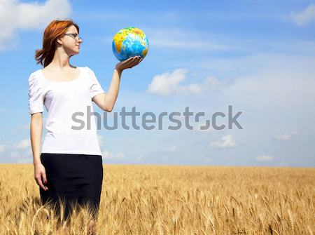 Young Businesswomen in white keeping globe in hand Stock photo © Massonforstock