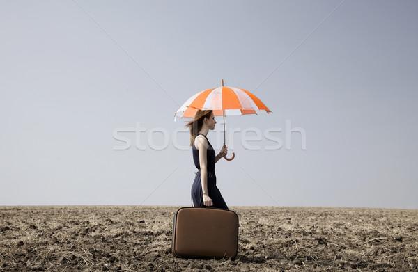 赤毛 少女 傘 スーツケース 風の強い 草 ストックフォト © Massonforstock