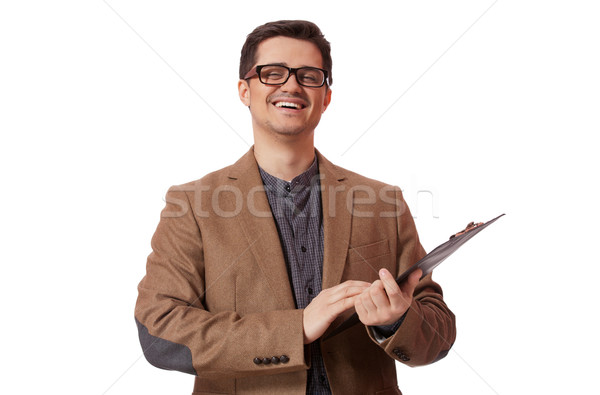 Young business man holding a clip board over white background Stock photo © Massonforstock