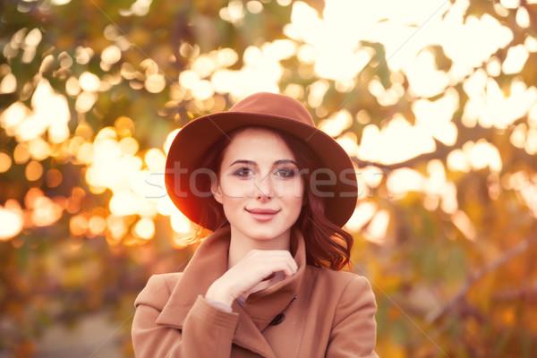 женщину Hat пальто осень время Открытый Сток-фото © Massonforstock