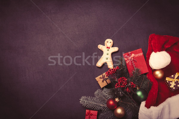Gingerbread man and christmas gifts Stock photo © Massonforstock
