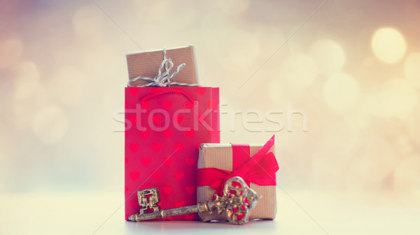 cool shopping bag, golden key and beautiful gifts on the fairy l Stock photo © Massonforstock