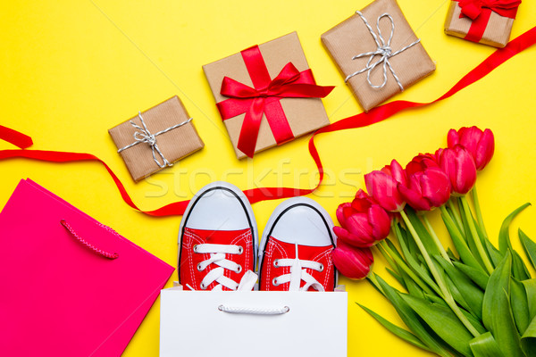 bunch of red tulips, red gumshoes, cool shopping bags, ribbon an Stock photo © Massonforstock