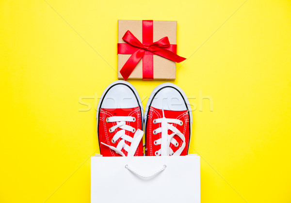 big red gumshoes in cool shopping bag and cute gift on the wonde Stock photo © Massonforstock