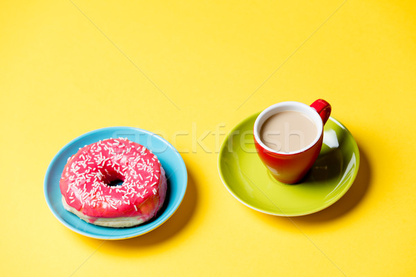 tasty glazed donut and cup of coffee on plates on the wonderful  Stock photo © Massonforstock