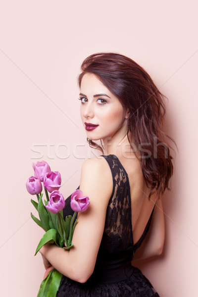 beautiful young woman with bunch of tulips on the wonderful pink Stock photo © Massonforstock