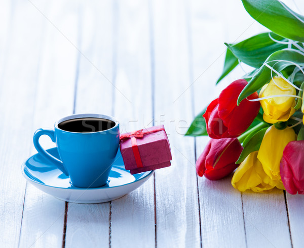 bunch of tulips, cup of coffee and gift on the wonderful white w Stock photo © Massonforstock