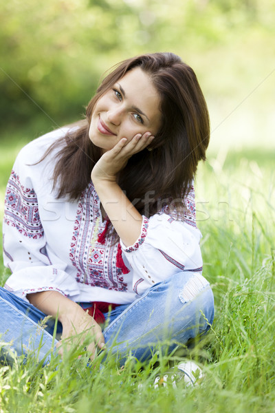 Slav teen girl at green meadow in national ukrainian clothing. Stock photo © Massonforstock