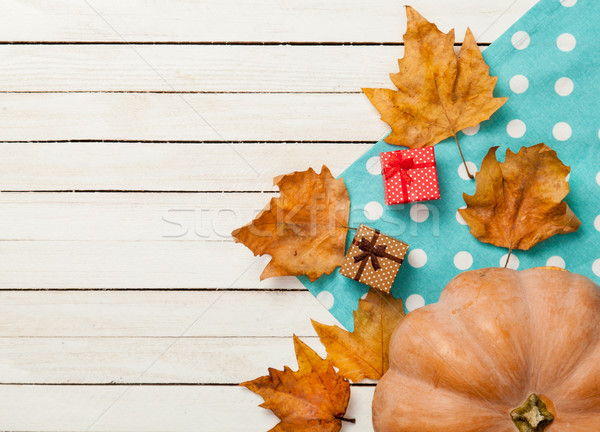 Pumpkin and leafs with gifts Stock photo © Massonforstock