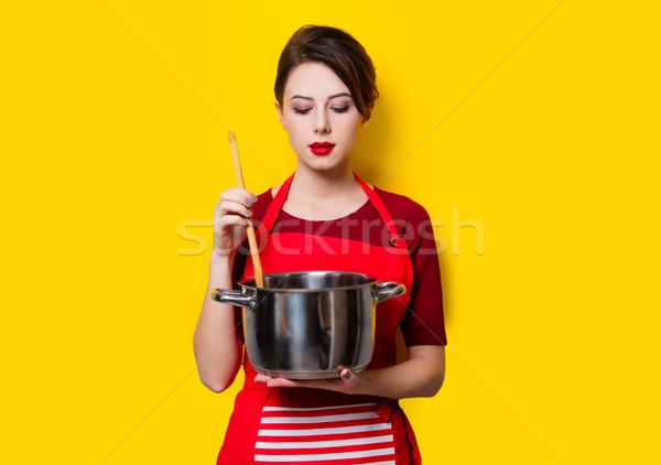 young housewife with pan and spoon  Stock photo © Massonforstock