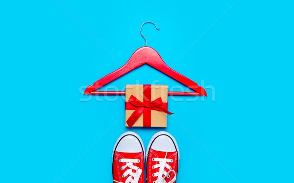big red gumshoes, hanger and beautiful gift on the wonderful blu Stock photo © Massonforstock