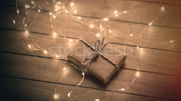 beautiful cute gift with ribbon and garland lying on the wonderf Stock photo © Massonforstock