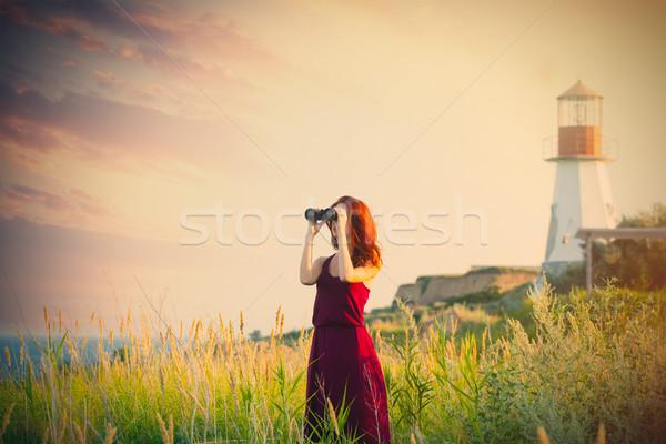 Belle jeune femme jumelles merveilleux mer phare Photo stock © Massonforstock