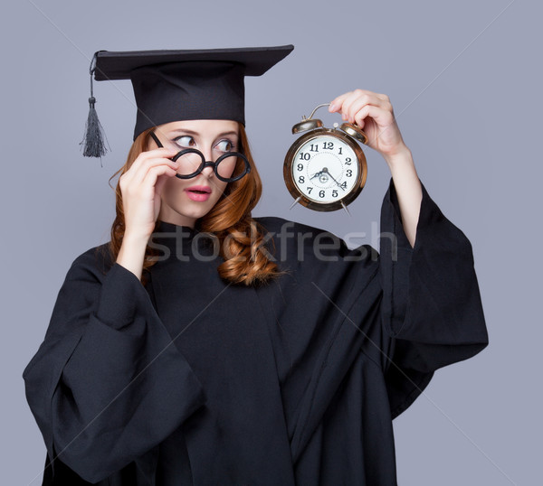 photo of beautiful young alumnus with alarm clock on the wonderf Stock photo © Massonforstock