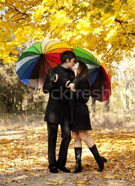 Couple kissing at alley in the park.  Stock photo © Massonforstock
