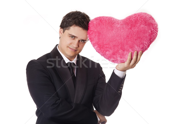 A man holding toy heart in formal black tux with tie isolated on Stock photo © Massonforstock