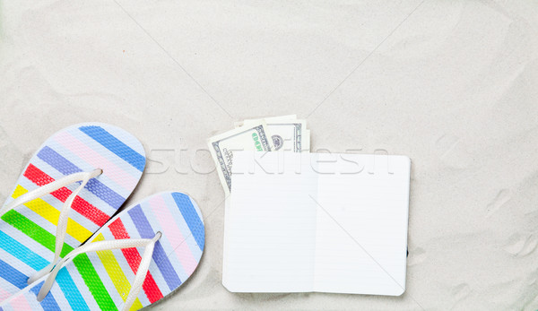 Színes papucs klasszikus notebook pénz fehér homok Stock fotó © Massonforstock