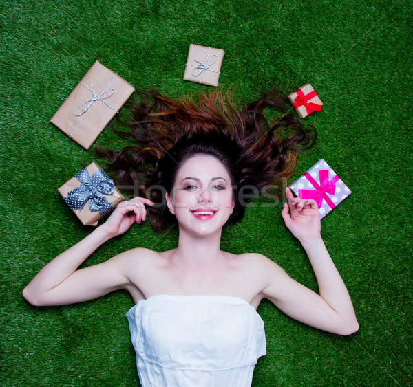Portrait of a young redhead woman with holiday gifts Stock photo © Massonforstock