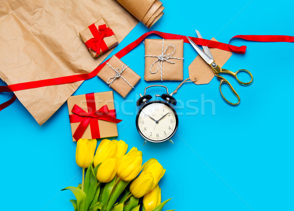 cute yellow tulips, beautiful gifts, alarm clock and cool things Stock photo © Massonforstock