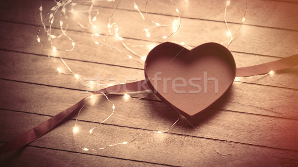 beautiful opened heart shaped box, ribbon and garland on the won Stock photo © Massonforstock