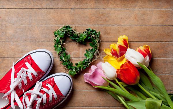 bunch of colorful tulips, heart shaped toy and gumshoes on the w Stock photo © Massonforstock