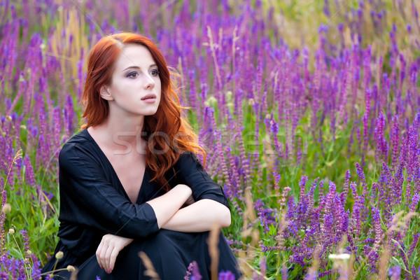 Gyönyörű fiatal nő ül megnyugtató csodálatos virágzó Stock fotó © Massonforstock