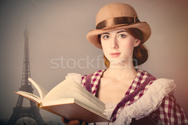 photo of beautiful young woman in vintage dress with book on Eif Stock photo © Massonforstock