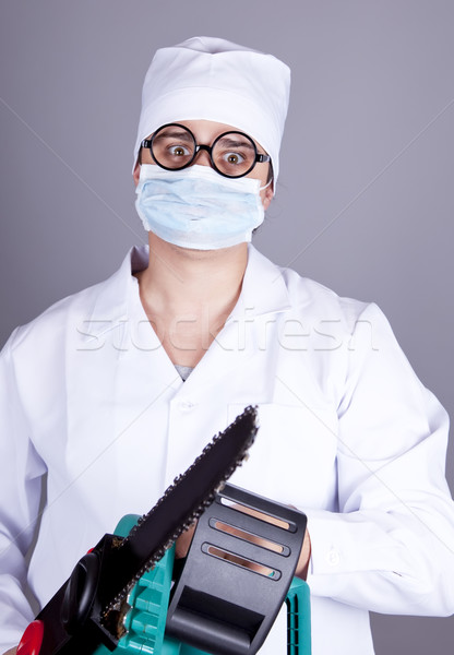 Crazy doctor with portable saw.  Stock photo © Massonforstock