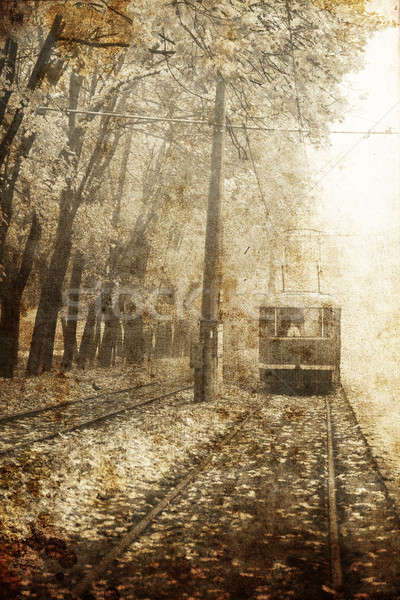 Tramway near autumn alley in Odessa, Ukraine. Photo in old image Stock photo © Massonforstock