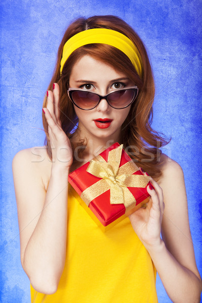 American redhead girl in sunglasses with gift. Stock photo © Massonforstock