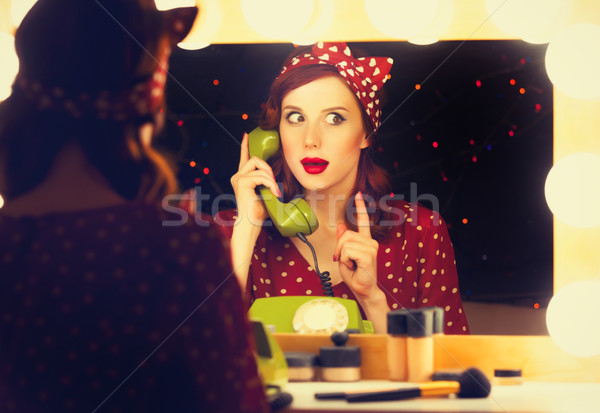 woman with dial phone applying cosmetics  Stock photo © Massonforstock