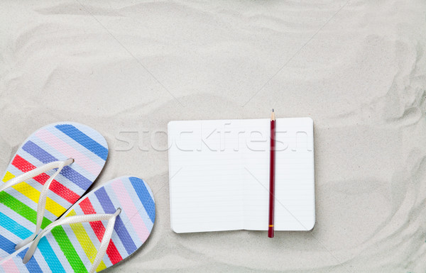 flip flops and classic notebook with pencil  Stock photo © Massonforstock