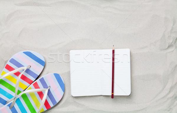 Papucs klasszikus notebook ceruza fehér homok fotó Stock fotó © Massonforstock